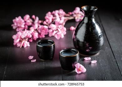 Unfiltered white sake on black table