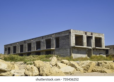 Unfinished building of gray block. Home construction.