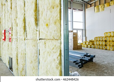 Unfinished building interior, heat isolation wall project with mineral wool is in progress.