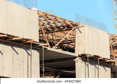 Unfinished cement building at a construction site in the summer