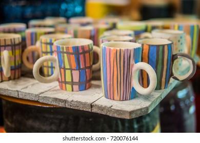 unfinished colorful ceramic mug painting