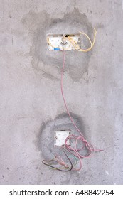Unfinished electricity wall socket. Open and under construction