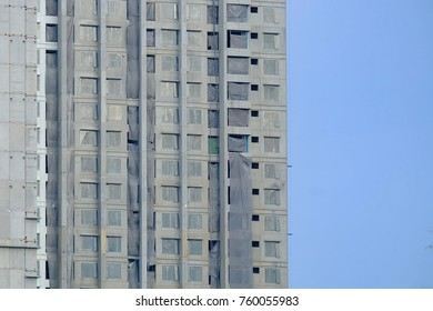 Unfinished high construction building in the city to view with blue sky background