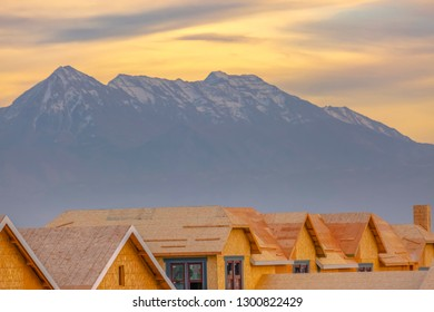 Unfinished homes and Mount Timpanogos in Utah