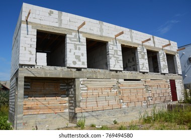 Unfinished House construction with autoclaved aerated concrete (AAC), also known as autoclaved cellular concrete.