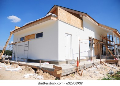 Unfinished house. Home Remodeling and Renovation. Painting house wall with stucco and plastering. Insulation House and Old House Renovation.