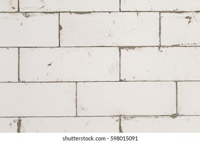 unfinished house wall builds from aerated concrete blocks (AAC autoclaved aerated concrete). material for interior design and construction industrial. background and texture.