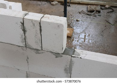 Unfinished house wall made from aerated concrete blocks