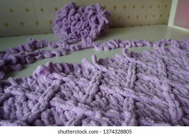 unfinished knitted blanket of yarn with loops