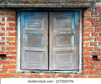 Unfinished old wooden window