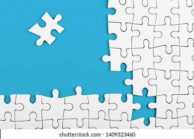 Unfinished white puzzle pieces on blue background. Business concept