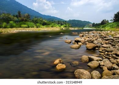 Un-focus image of Brook and rocks in the mountains at Kiriwong village, Nakorn Sri Thammarat., Thailand.