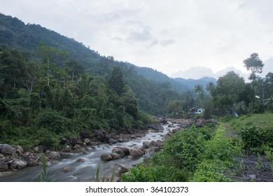 Un-focus image of Brook and rocks in the mountains at Kiriwong village, Nakorn Sri Thammarat , Thailand.