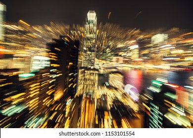 Unfocused, blurred zoom night view of a city Skyline