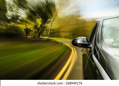 unfocused Car speeding.
