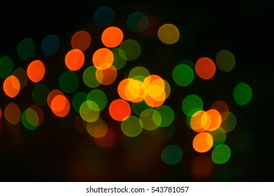 unfocused christmas background with colored lights