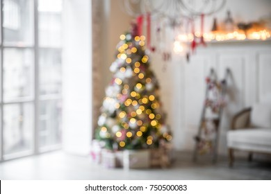 Unfocused classic white christmas interior with new year tree decorated.