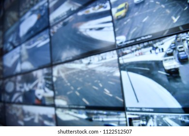 Unfocused image with security surveillance monitors command center