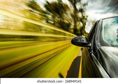 unfocused Mirror view of speeding car