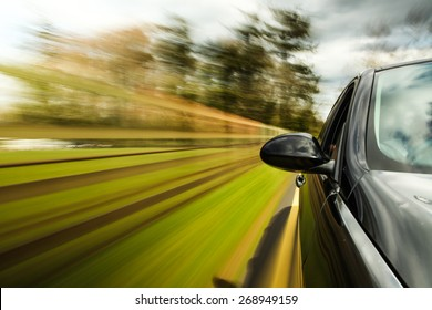 unfocused Mirror view of speeding car.