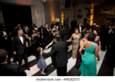 Unfocused photo of people dancing at a party