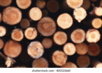 Unfocused wooden natural background, cutting circle logs