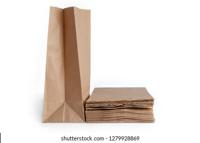 Unfold paper bag and pile of new kraft paper bags  isolated on white background . Brown paper bags with clipping path .