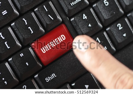 unfriend word on red keyboard button