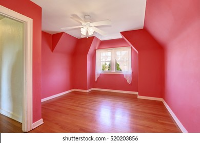 Unfurnished room with bright red walls and hardwood floor. Tudor house interior