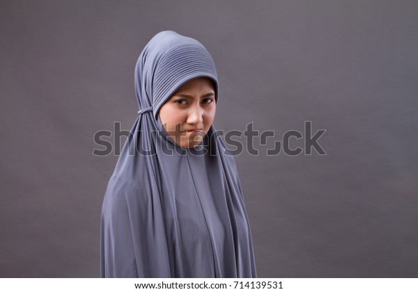 unhappy angry frustrated upset muslim woman portrait, with hijab or head scarf