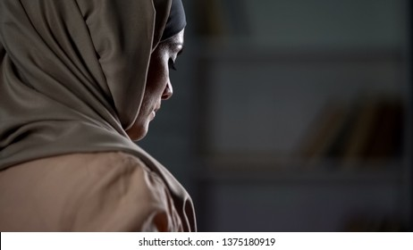 Unhappy arab woman in hijab close-up, pessimistic mood, sorrow, melancholy