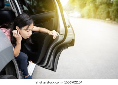 Unhappy asian child girl about to throw up from car sick or indigestion,female teenage vomiting in a car suffers from motion sickness or food poisoning,sad woman feel dizzy and nauseous from carsick