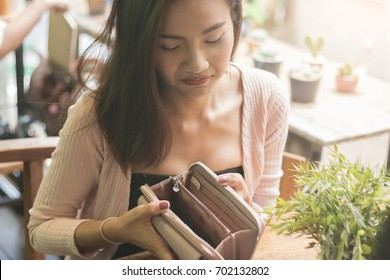 Unhappy bankrupt woman with empty wallet.  Bankruptcy