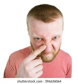 Unhappy bearded man pointing at a pimple on his nose