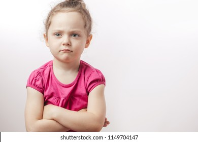 unhappy beautiful ginger girl with crossed arms is expressing disagreement. body language. caprice