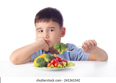 Unhappy boy doesn't want eat healthy vegetables.