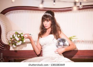 Unhappy bride with a disco ball