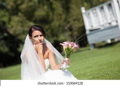 Unhappy bride with a wedding bouquet