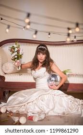 Unhappy bride wielding her wedding bouquet