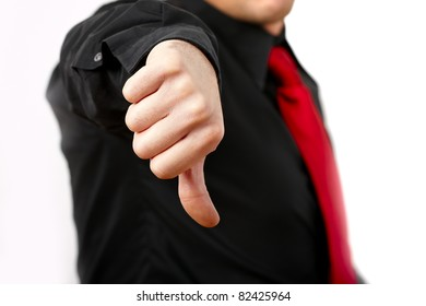 Unhappy business man thumbs down sign.