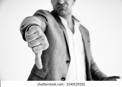 Unhappy Businessman or casual man showing thumbs Down or Dislike sign or Gesture Bored after meeting or Business negotiations are not successful. business Ideas, problems or obstacles concept