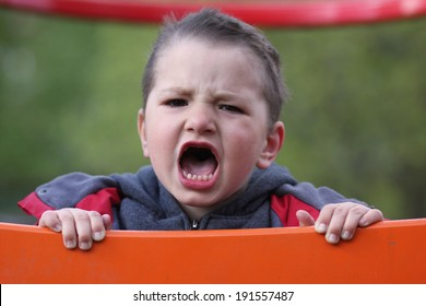 Unhappy child cries