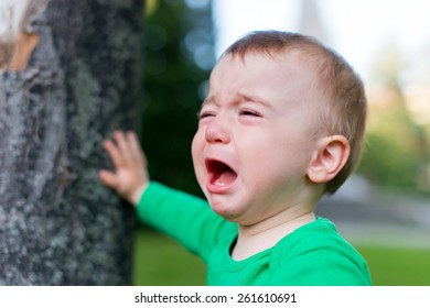 Unhappy child on the nature background