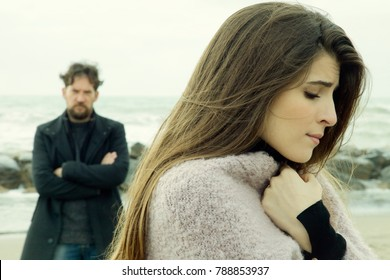 unhappy couple after fight feeling sad