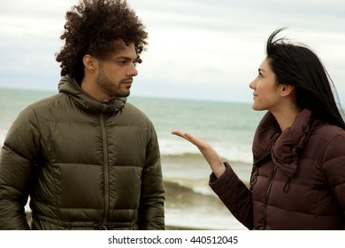 Unhappy couple discussing in winter