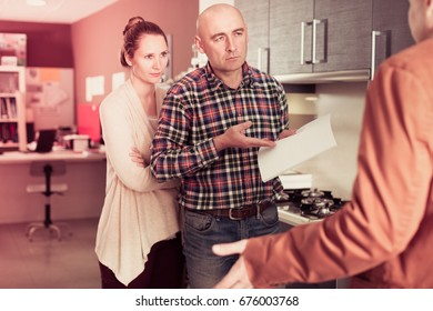 Unhappy couple is dissatisfied with the quality of service