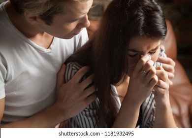 Unhappy couple. Girl crying guy calms her. Husband after the quarrel apologize, interruption of unwanted pregnancy, miscarriage. Friend support girlfriend after disagreement with a loved one, divorce