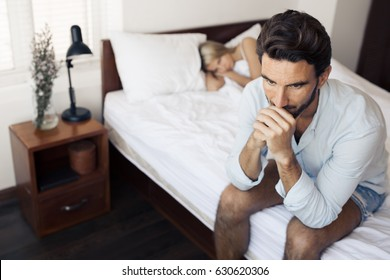 Unhappy couple having problems at bedroom. Family conflict.