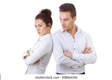 Unhappy couple not talking after an argument against white isolated background