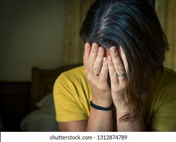 Unhappy crying woman in depression covered her face